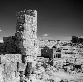 """Remains of Byzantine houses, Serjilla Serjilla is one of the more than seven hundred so-called """"dead cities"""": deserted Byzantine towns in northwestern Syria. These towns flourished between the first and seventh centuries A.D. and were mostly abandoned during the course of the eighth, ninth, and tenth centuries."""