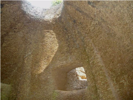A-well-crafted-rock-cut-chamber-in-Kerala.png