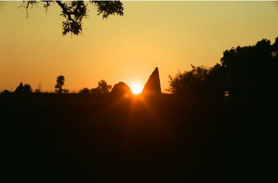 Winter-Solstice-sunset-framed-by-two-Menhirs-at-Nilaskal-in-Southern-India